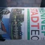 Eingerollte Lokalzeitung vom Hennefer Stadt Echo in einem Zeitungsrohr